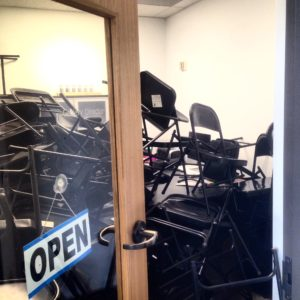 black metal chairs stacked in office